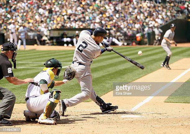 Derek Jeter of the New York Yankees hits a sacrifice fly in the seventh inning that scored Brett Gardner of the New York Yankees during their game...
