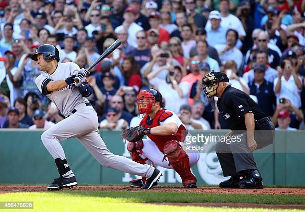 Derek Jeter of the New York Yankees hits a single for his last career at bat in the third inning against the Boston Red Sox during the last game of...