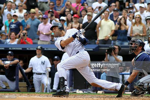 Derek Jeter of the New York Yankees hits a solo home run in the third inning for career hit 3000 while playing against the Tampa Bay Rays at Yankee...