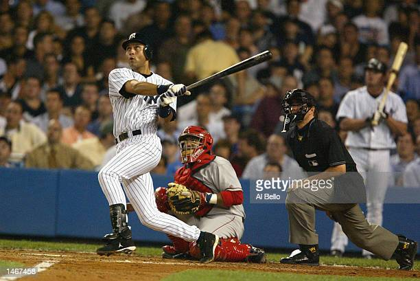 Derek Jeter of the New York Yankees hits a solo home run in the third inning against the Anaheim Angels during game 2 of the American League Division...