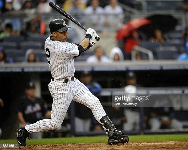 Derek Jeter of the New York Yankees hits an RBI single in the seventh inning against the New York Mets on June 13 2009 at Yankee Stadium in the Bronx...