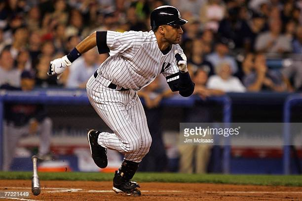 Derek Jeter of the New York Yankees hits into a double play during Game Three of the American League Division Series against the Cleveland Indians at...
