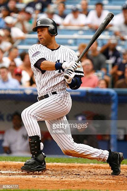 Derek Jeter of the New York Yankees hits the ball against the Tampa Bay Rays during the first game of a day-night doubleheader on September 13, 2008...
