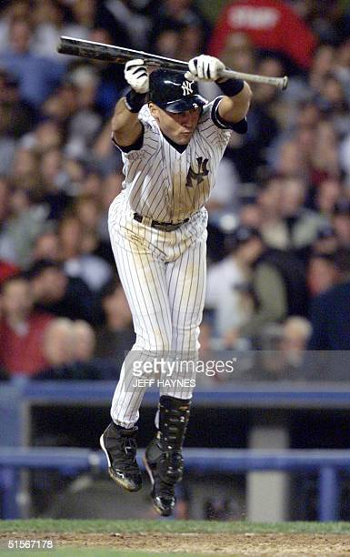 Derek Jeter of the New York Yankees is brushed back as he tries to bunt in the 7th inning against the New York Mets in game 1 of the World Series 21...