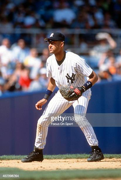 Derek Jeter of the New York Yankees is down an ready to make a play on the ball during an Major League Baseball game circa 2002 at Yankee Stadium in...