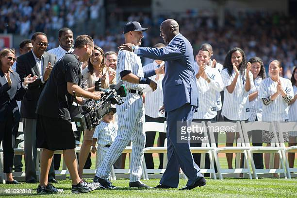 Derek Jeter of the New York Yankees is greeted by NBA Legend and Hall of Famer Michael Jordan during Derek Jeter Day before the game between the New...