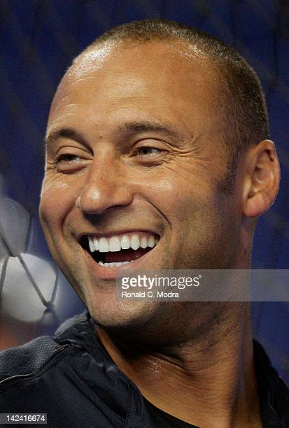 Derek Jeter of the New York Yankees laughs prior to a preseason game against the Miami Marlins at Marlins Park on April 2 2012 in Miami Florida