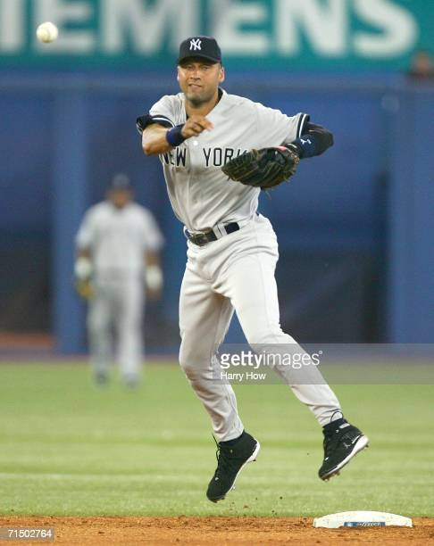 Derek Jeter of the New York Yankees makes a throw to first for an out against the Toronto Blue Jays during the third inning on July 22 2006 at the...