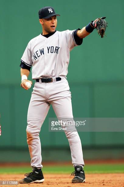 Derek Jeter of the New York Yankees points out to rightfield after rightfielder Gary Sheffield threw to second base and forced out Johnny Damon of...