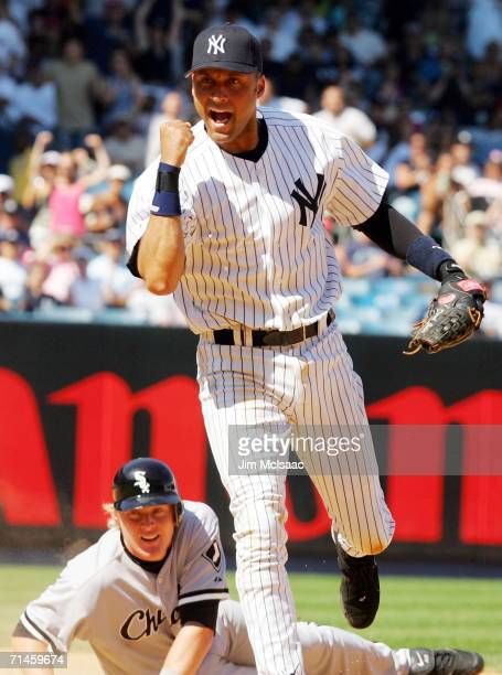 Derek Jeter of the New York Yankees pumps his fist after completing a double play to end an eighth inning rally against the Chicago White Sox as...
