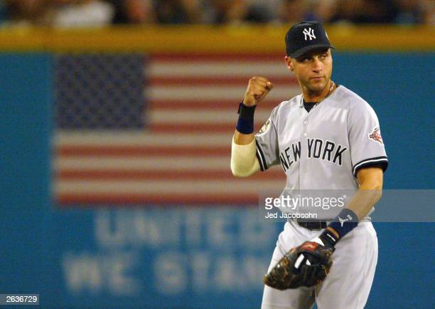 Derek Jeter of the New York Yankees pumps his fist after fielding a groundball hit by Luis Castillo of the Florida Marlins in the first inning during...