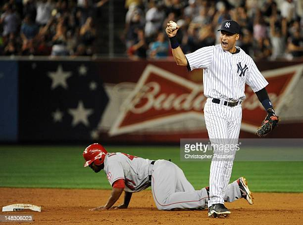Derek Jeter of the New York Yankees reacts after tagging out Howard Kendrick of the Los Angeles Angels of Anaheim to end the game at Yankee Stadium...