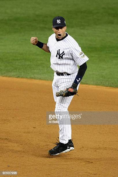 Derek Jeter of the New York Yankees reacts after turning a double play to end the eighth inning against the Philadelphia Phillies in Game Two of the...