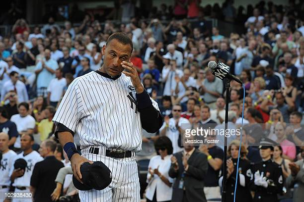 Derek Jeter of the New York Yankees reacts during the ceremony for Yankee Owner George Steinbrenner before the game against theTampa Bay Rays on July...