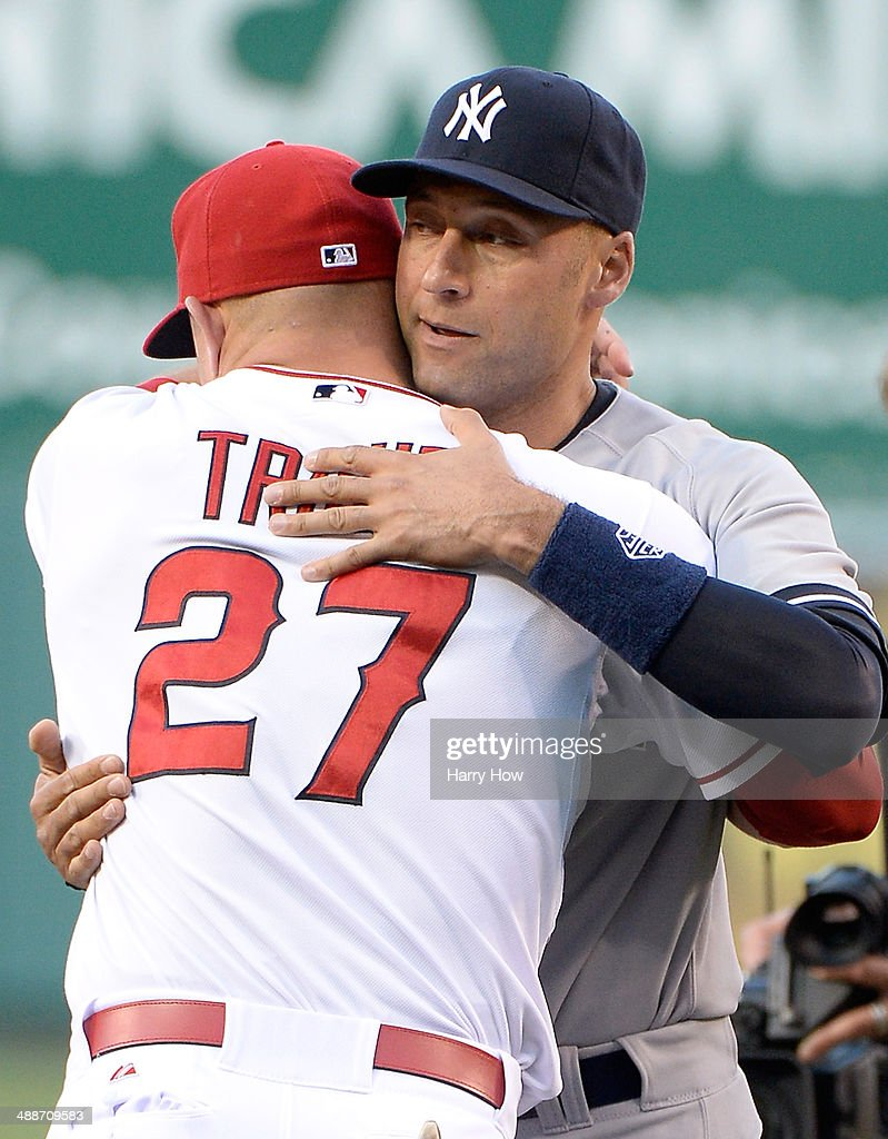 Derek Jeter #2 of the New York Yankees receives a hug from Mike Trout #27 of the Los Angeles Angels before the game at Angel Stadium of Anaheim on May 7, 2014 in Anaheim, California.