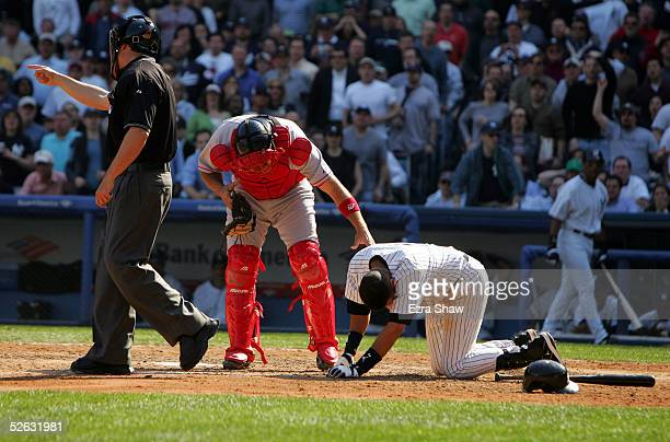Derek Jeter of the New York Yankees rests on his hands and knees after being hit by the first pitch of his at bat in the eighth inning of the game as...