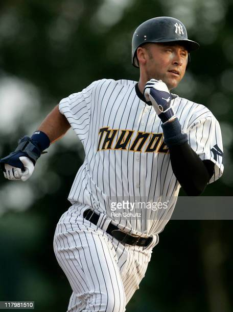 Derek Jeter of the New York Yankees rounds second base on his way to third after singling in the first inning of his minor league rehab start with...