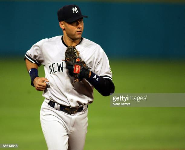 Derek Jeter of the New York Yankees runs on the field against the Florida Marlins at Landshark Stadium on June 19 2009 in Miami Florida The Yankees...