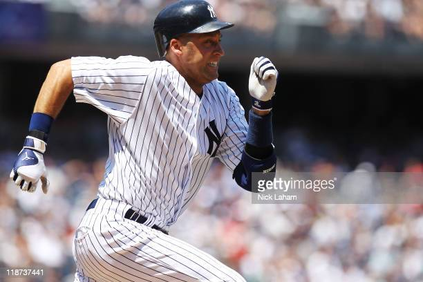 Derek Jeter of the New York Yankees runs out a single in the third inning against the Tampa Bay Rays at Yankee Stadium on July 10, 2011 in the Bronx...