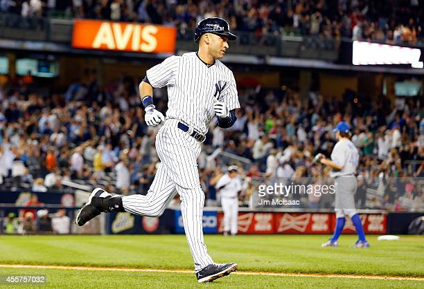 Derek Jeter of the New York Yankees runs the bases after his sixth inning home run against RA Dickey of the Toronto Blue Jays at Yankee Stadium on...