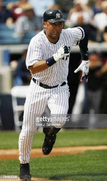 Derek Jeter of the New York Yankees runs to first base after hitting against the Minnesota Twins during a Spring Training game on March 1, 2007 at...