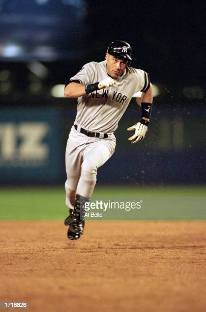 Derek Jeter of the New York Yankees runs to third base after hitting a triple in the third inning during game four of the World Series against the...