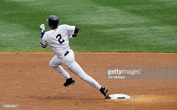 Derek Jeter of the New York Yankees runs to third base during the first inning against the Seattle Mariners on August 21 2010 at Yankee Stadium in...