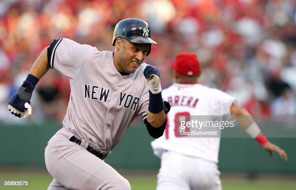 Derek Jeter of the New York Yankees runs to third base on a hit by Gary Sheffield of the Yankees in the first inning against the Los Angeles Angels...