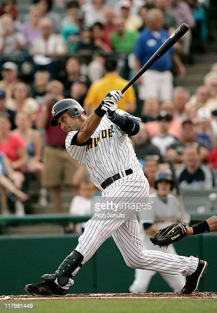 Derek Jeter of the New York Yankees singles in his first atbat of his minor league rehab start with the Trenton Thunder in a game against the Altoona...