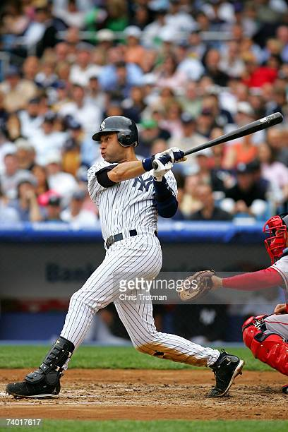 Derek Jeter of the New York Yankees singles in the third inning against the Boston Red Sox at Yankee Stadium on April 28, 2007 in the Bronx borough...