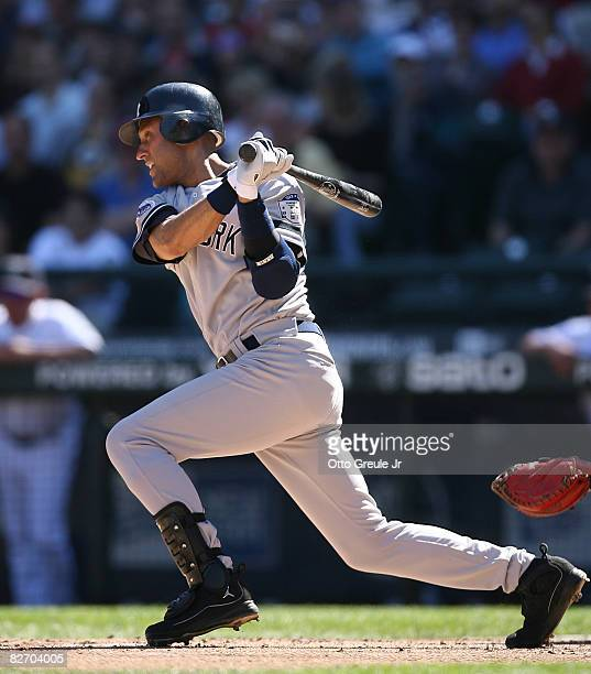 Derek Jeter of the New York Yankees singles in the third inning against the Seattle Mariners on September 7, 2008 at Safeco Field in Seattle...
