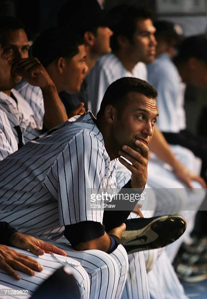 Derek Jeter of the New York Yankees sits in the dugout during a rain delay after the top of the first inning of their game against the Florida...