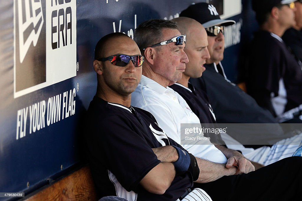 Derek Jeter #2 of the New York Yankees sits in the dugout in the third inning of a game againt the Boton Red Sox at George M. Steinbrenner Field on March 18, 2014 in Tampa, Florida.