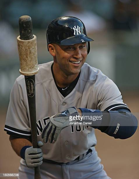 Derek Jeter of the New York Yankees smiles before hitting the first pitch of the game for a home run against the Chicago White Sox at U.S. Cellular...