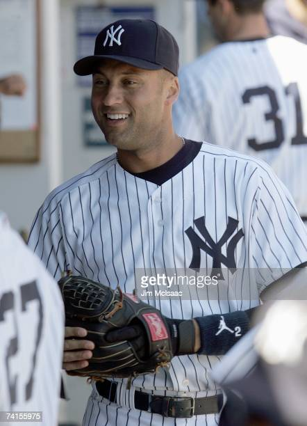 Derek Jeter of the New York Yankees smiles in the dugout against the Seattle Mariners at Yankee Stadium on May 6 2007 in the Bronx borough of New...