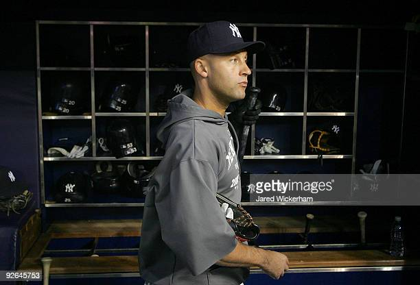 Derek Jeter of the New York Yankees stands in the dugout during World Series workouts on November 3 2009 at Yankee Stadium in the Bronx borough of...