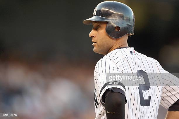 Derek Jeter of the New York Yankees stands on first base after hitting a single against the Minnesota Twins during their game on July 2, 2007 at...
