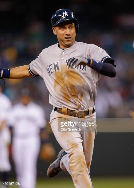 Derek Jeter of the New York Yankees steals third base in the seventh inning against the Seattle Mariners at Safeco Field on June 11 2014 in Seattle...