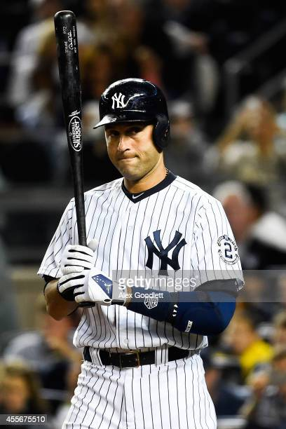Derek Jeter of the New York Yankees steps away from the plate in the fourth inning during a game against the Toronto Blue Jays at Yankee Stadium on...