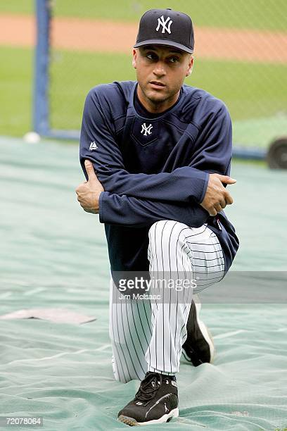 Derek Jeter of the New York Yankees stretches during batting practice prior to the start of game one of the American League Division Series against...