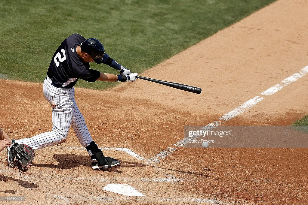 Derek Jeter #2 of the New York Yankees swings at a pitch in the fourth inning of a game against the Boston Red Sox at George M. Steinbrenner Field on March 18, 2014 in Tampa, Florida.