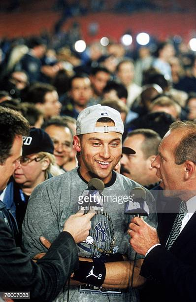 Derek Jeter of the New York Yankees talks to the media as the Yankees take Game Five to win the 2000 World Series against the New York Mets at Shea...