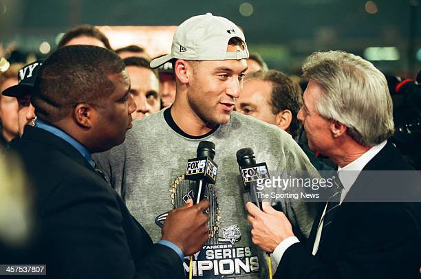 Derek Jeter of the New York Yankees talks to the media following Game Five of the World Series against the New York Mets on October 26 2000 at Shea...