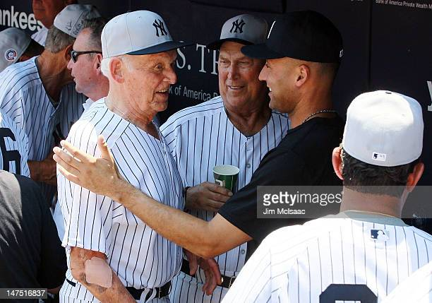 Derek Jeter of the New York Yankees talks with former Yankee Don Larsen during the Yankees 66th Annual Old Timers Day prior to the game against the...