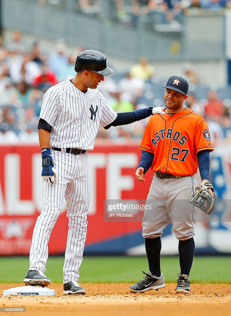 Derek Jeter #2 of the New York Yankees talks with Jose Altuve #27 of the Houston Astros during their game at Yankee Stadium on August 21, 2014 in the Bronx borough of New York City. The Yankees defeated the Astros 3-0.