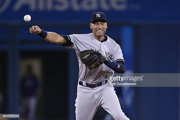Derek Jeter of the New York Yankees throws out the baserunner in the ninth inning during MLB game action against the Toronto Blue Jays on August 29...