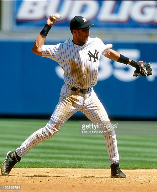 Derek Jeter of the New York Yankees throws the ball to first base during an Major League Baseball game circa 2002 at Yankee Stadium in the Bronx...