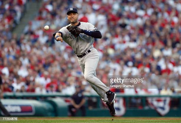 Derek Jeter of the New York Yankees throws the ball to first base to force out Ryan Garko of the Cleveland Indians in the bottom of the second inning...