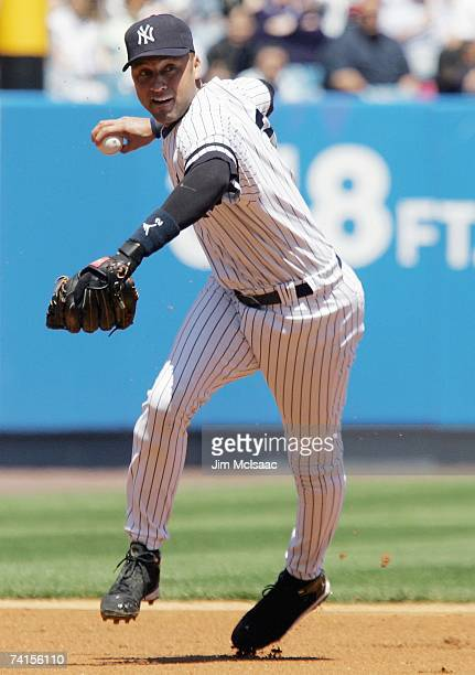 Derek Jeter of the New York Yankees throws to firstbase against the Seattle Mariners at Yankee Stadium on May 6 2007 in the Bronx borough of New York...