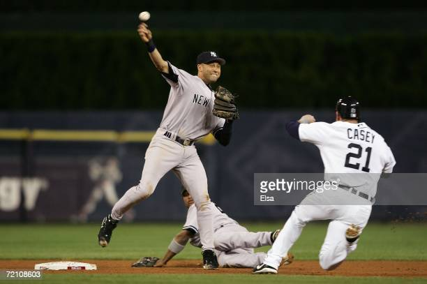 Derek Jeter of the New York Yankees unsuccessfully attempts to turn a double play after he forced out a sliding Sean Casey of the Detroit Tigers in...
